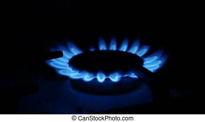 Domestic gas stove is lit blue gas video - Domestic gas...