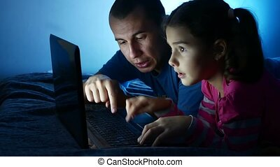 girl teen and man father and daughter working at laptop, the...