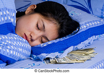 woman with money under her pillow - woman sleeping with...