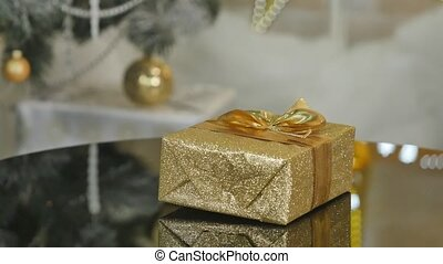 Gift in gold spining box under tree for Christmas
