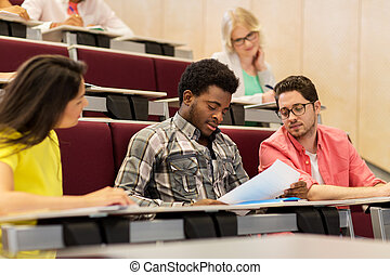 group of international students in lecture hall - education,...