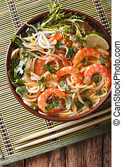 Malaysian laksa soup with prawns close up in a bowl....
