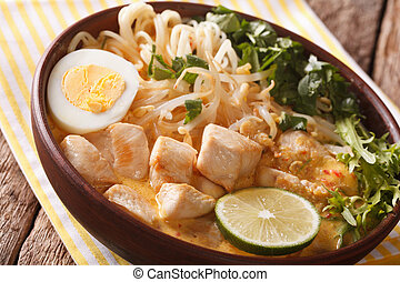 Asian Laksa soup with chicken, egg, noodles, sprouts and...