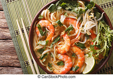 Laksa soup with shrimps, noodles, sprouts and coriander in a...