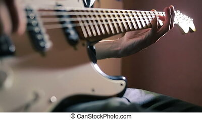 Hands of man playing electric guitar. Bend technique. rock musician