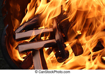 Bright flames on wood - Charred wood and bright flames on...