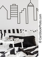 Headboard wall idea in black and white bedroom