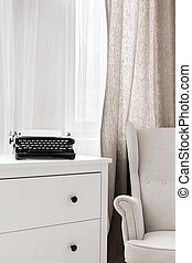 Typewriter on commode - Close-up of old manual typewriter on...