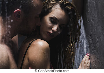 Enjoying shower together - Shot of a beautiful woman taking...