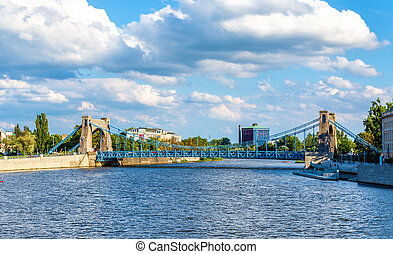 Grunwaldzki suspension bridge over river Odra in Wroclaw,...
