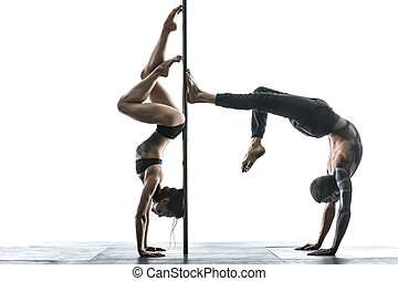 Posing of pole dance couple in studio - Charming couple of...