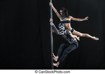 Posing of pole dance couple in dark studio - Awesome couple...