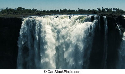 Victoria Falls detail - Huge amount of water falling in the...