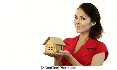 Happy woman holding a little house in her hands - Home - new...