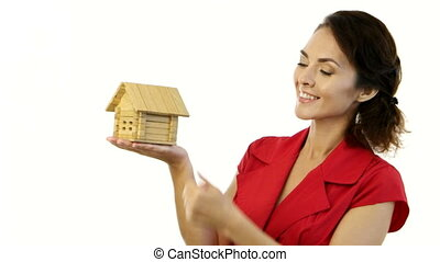 Happy woman holding a little house in her hands