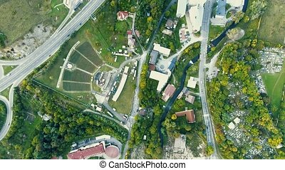 Aerial view, town with houses, roads, nature and cementery -...