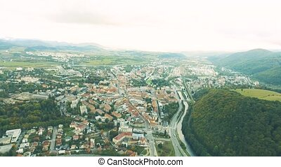Aerial view of slovak town Banska Bystrica surrounded by...