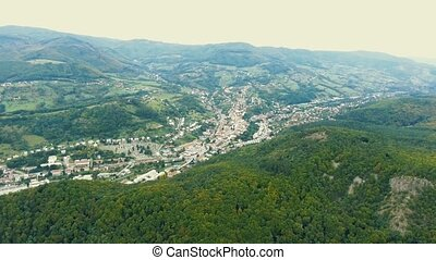 Aerial view of small town with hills, Slovakia. - Aerial...