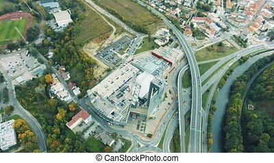 Aerial view, high building, highway and river passing...
