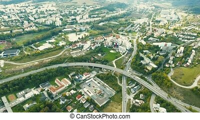 Highway crossing slovak town, aerial view. Banska Bystrica,...