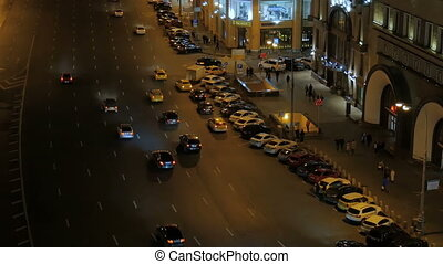 The movement of cars in the evening. - The movement of cars...