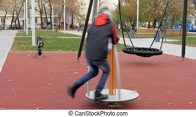 A child plays on the playground. - A child plays on the...