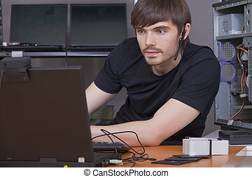 male programmer with headset