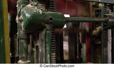 View of sawing machine during operation, close-up - Sawmill....