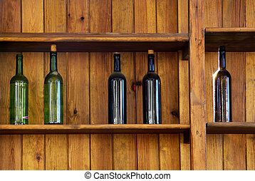 Five Bottles - Five wine bottles without label in an old...