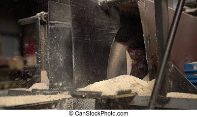 Sawdust flying in all directions during log sawing - View of...