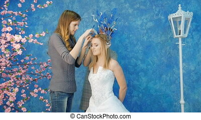 Make-up artist and stylist make the image of the elven...