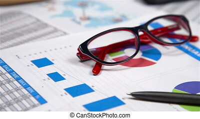 Red Glasses And Report - Office Desktop With Red Glasses And...