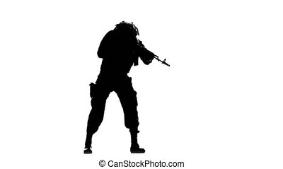 Soldier takes aim. Silhouette - Soldier takes aim, a man in...