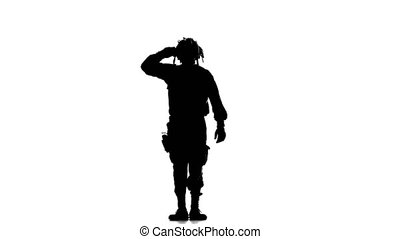 Person silhouetted raises arm and looks out in search for...