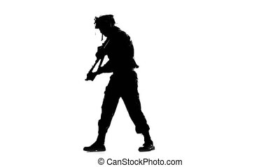 Man points the gun down and to the sides. Silhouette - Man...