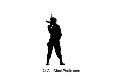 Soldier aimed and looking around. Silhouette - Soldier aimed...