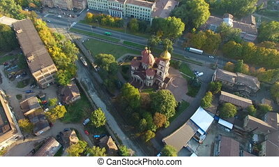 Church in the city. Aerial survey - Flying over the church...