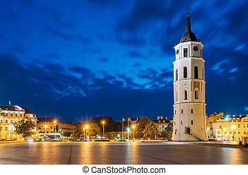Vilnius, Lithuania. Night Or Evening View Of Bell Tower Near...