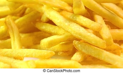 Adding tomato ketchup to french fries. Popular fast food, deep fried potato chips. Super slow motion macro video