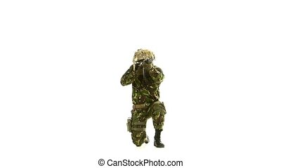Armed soldier stands on one knee. White backgraund - Armed...
