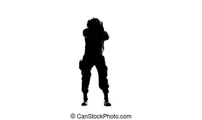 Soldier with a pistol in his hand. Silhouette - Soldier with...