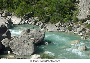 French lower alpine valley river - Clear pale blue fast...