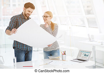 Two architects working together in office - Working as team....