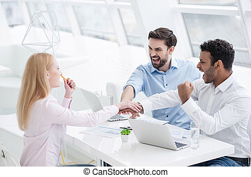 Young coworkers having brainstorming session in modern...