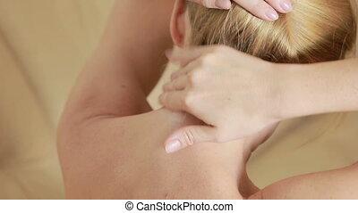 sick neck. Woman rubs her neck cream. neck massage