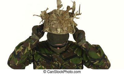 Soldier wears a helmet on his head. White backgraund -...