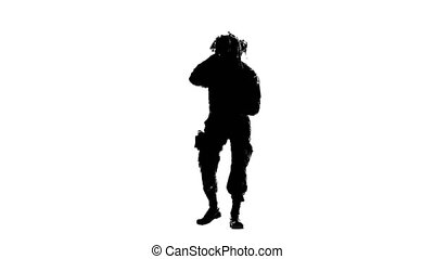 Armed soldier stands on one knee. Silhouette - Armed soldier...