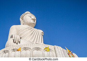 The Big Buddha in the blue sky, front view. Nakkerd hills in...