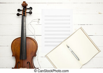 violin with music paper note and notebook