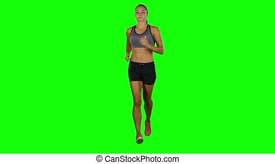 Running sport girl. Sport. Jogging. Front view. Green screen...